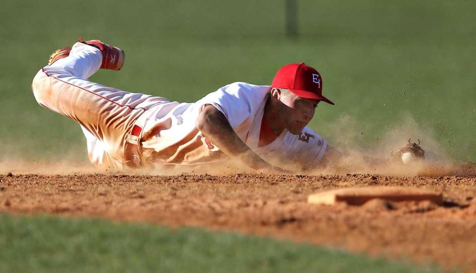 East Islip shortstop Paul Dondero knocks down a