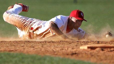 East Islip shortstop Paul Dondero knocks down a