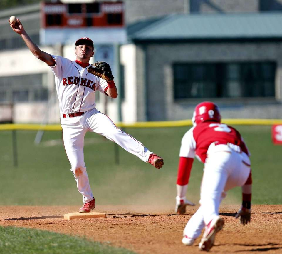 East Islip shortstop Paul Dondero forces Hills West's
