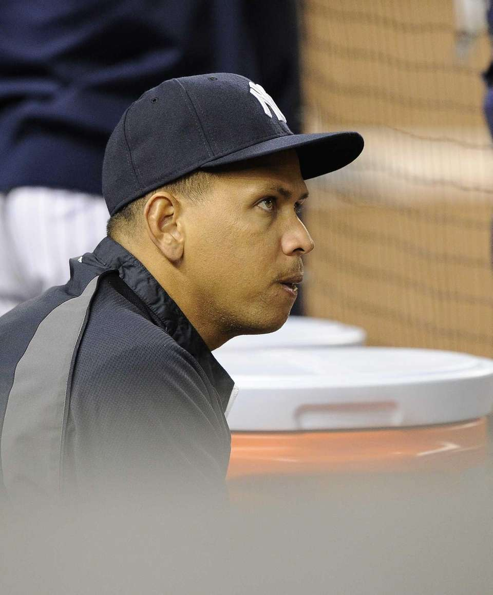 Yankees' Alex Rodriguez sits in the dugout in