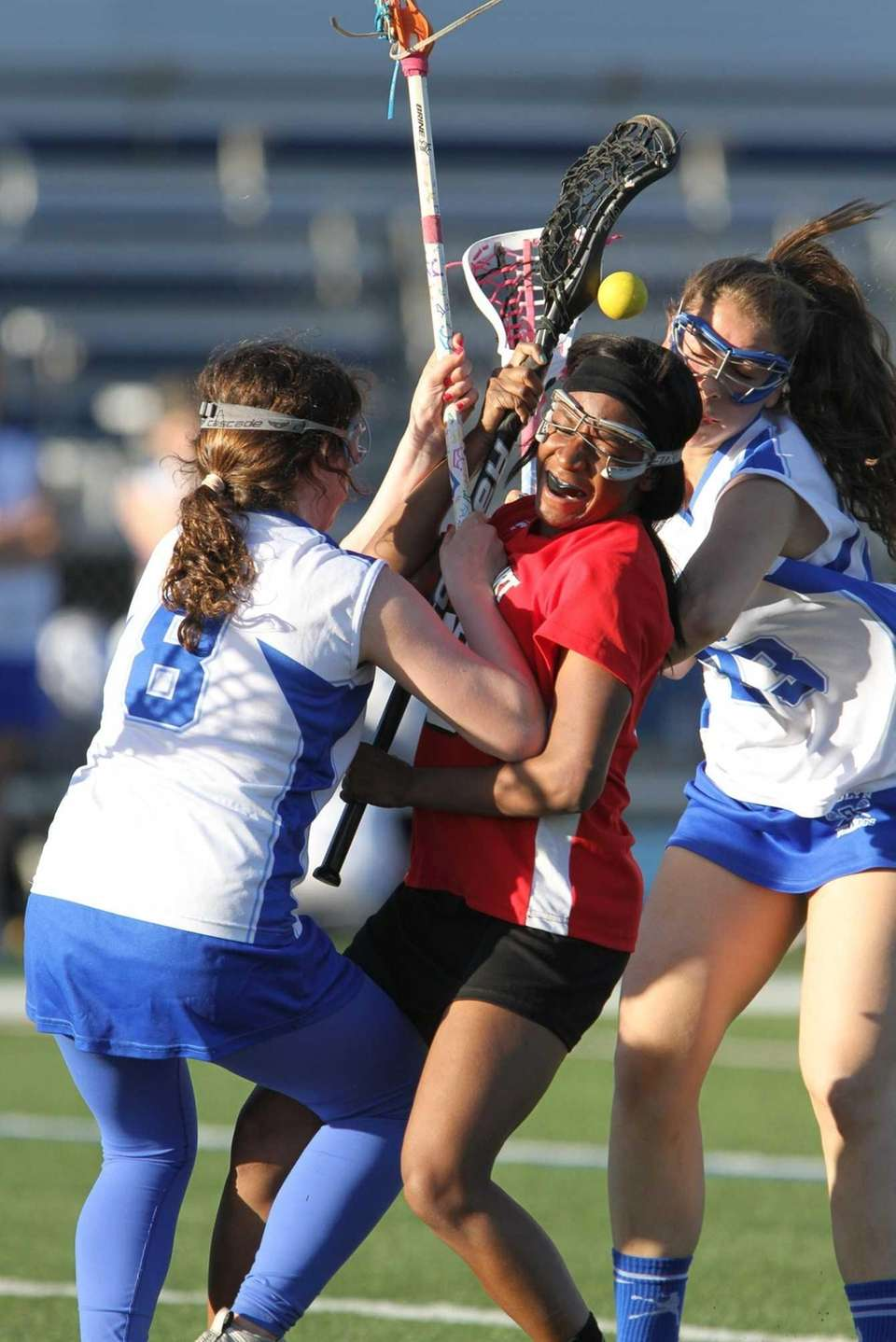 Roslyn's Reilly Liotta and Lidnesday Wolfe double-team Freeport's