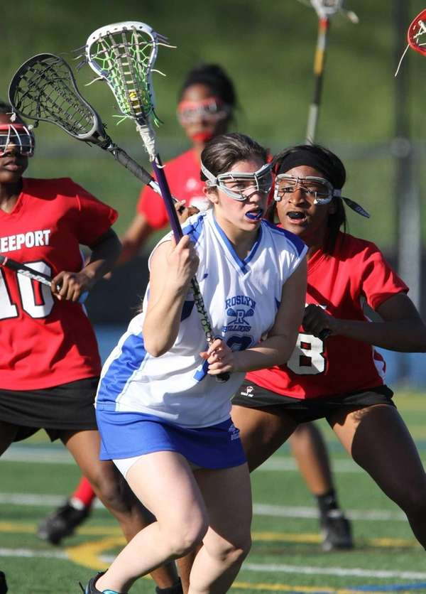 Roslyn's Lexi Singer trys to get by Freeport's