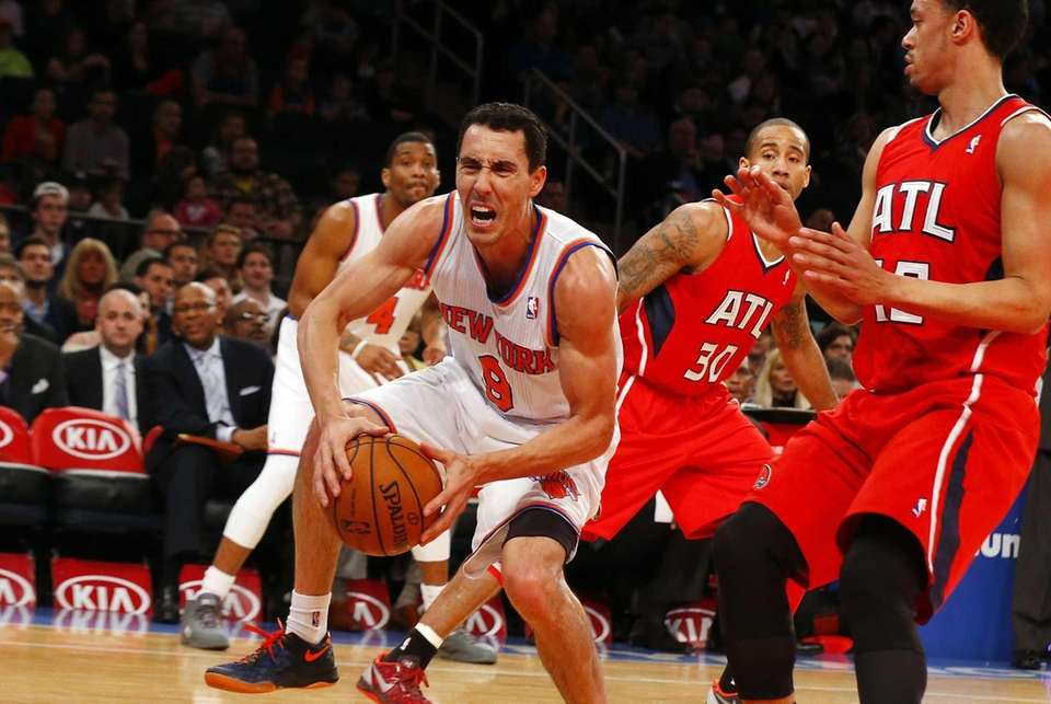 Pablo Prigioni grimaces after injuring his right ankle