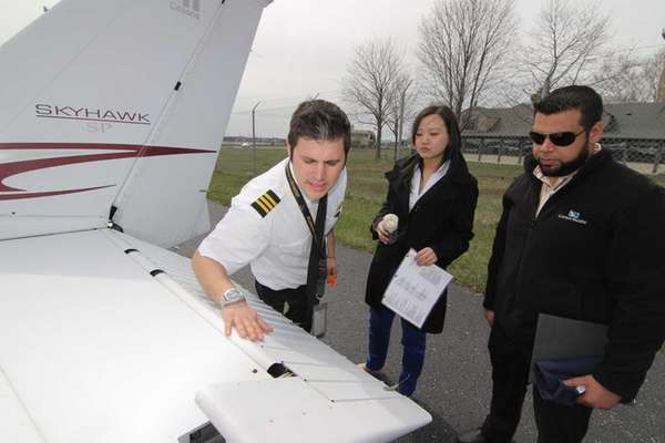 Flight instructor Isaac Shapiro, left, goes over a
