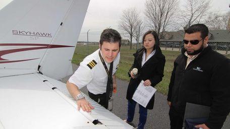 Flight instructor Isaac Shapiro, left, goes over a