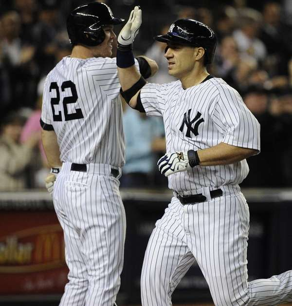 Travis Hafner celebrates his home run with Brennan