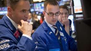 Traders at the New York Stock Exchange watch