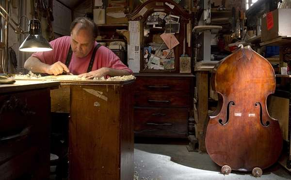 Violin maker Edward Maday works at his desk