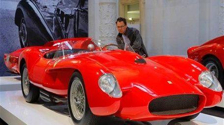 A visitor views the 1958 Ferrari 250 Testa
