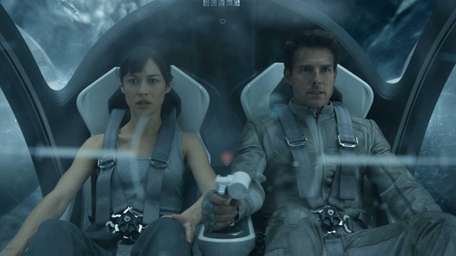 Olga Kurylenko and Tom Cruise in a scene