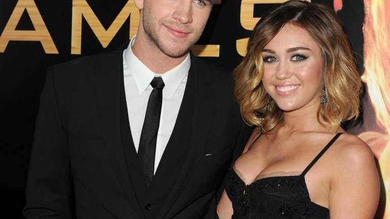 Liam Hemsworth and Miley Cyrus arrive at the