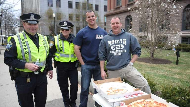 (L-R) Boston Police officers Rich Withington and Debbie