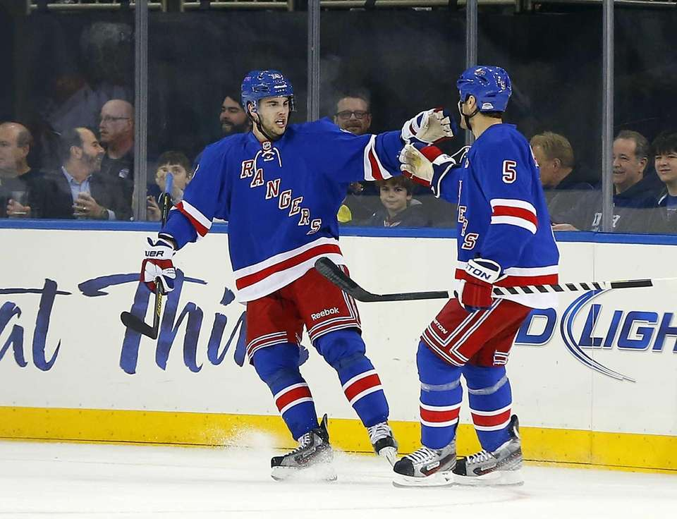 Derick Brassard of the Rangers celebrates his first