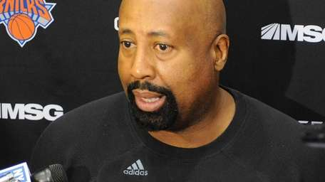 Mike Woodson speaks to the media during a