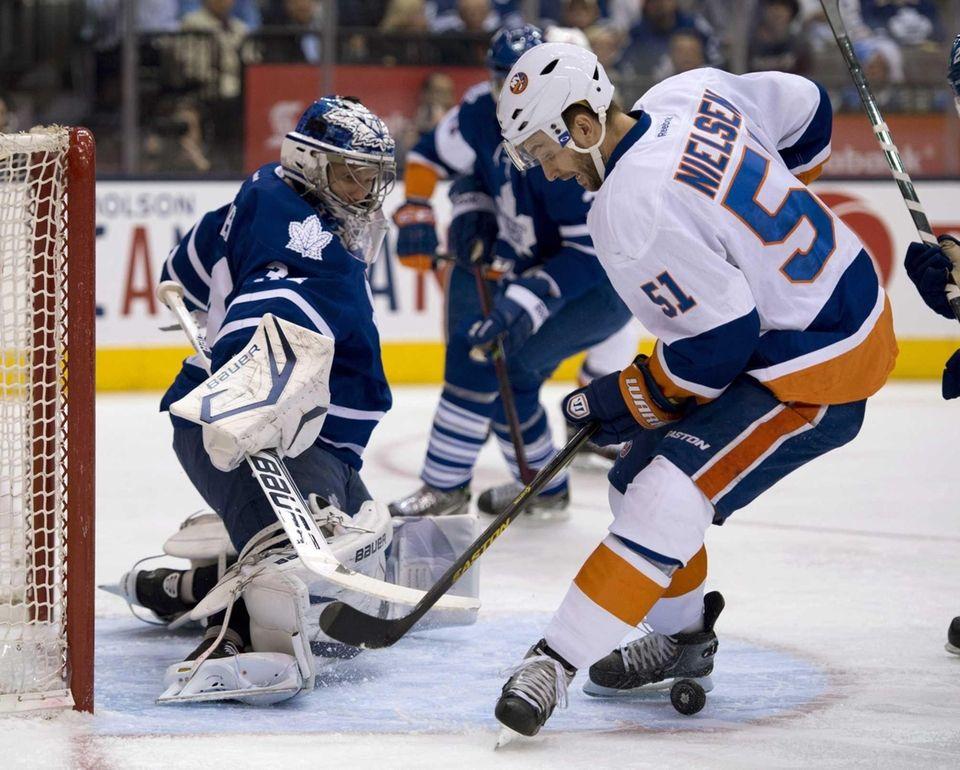 Toronto Maple Leafs goaltender James Reimer, left, and