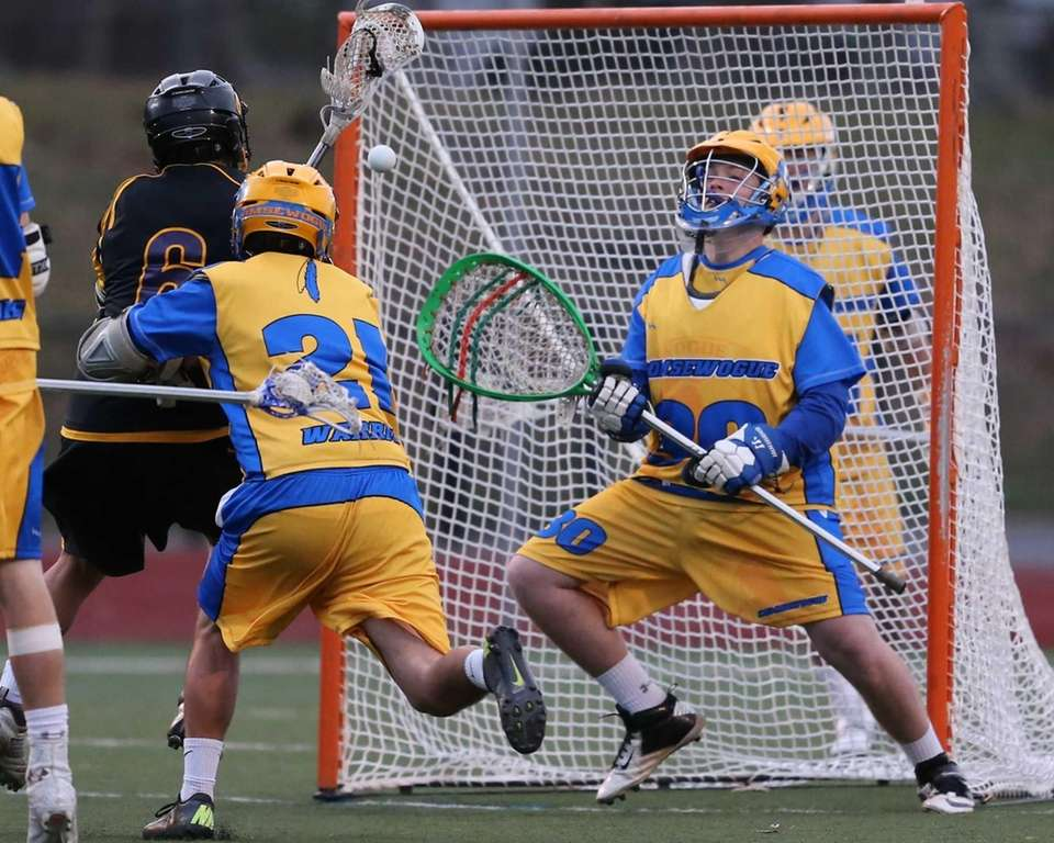 Comsewogue goalie Jake MacGregor makes a save from