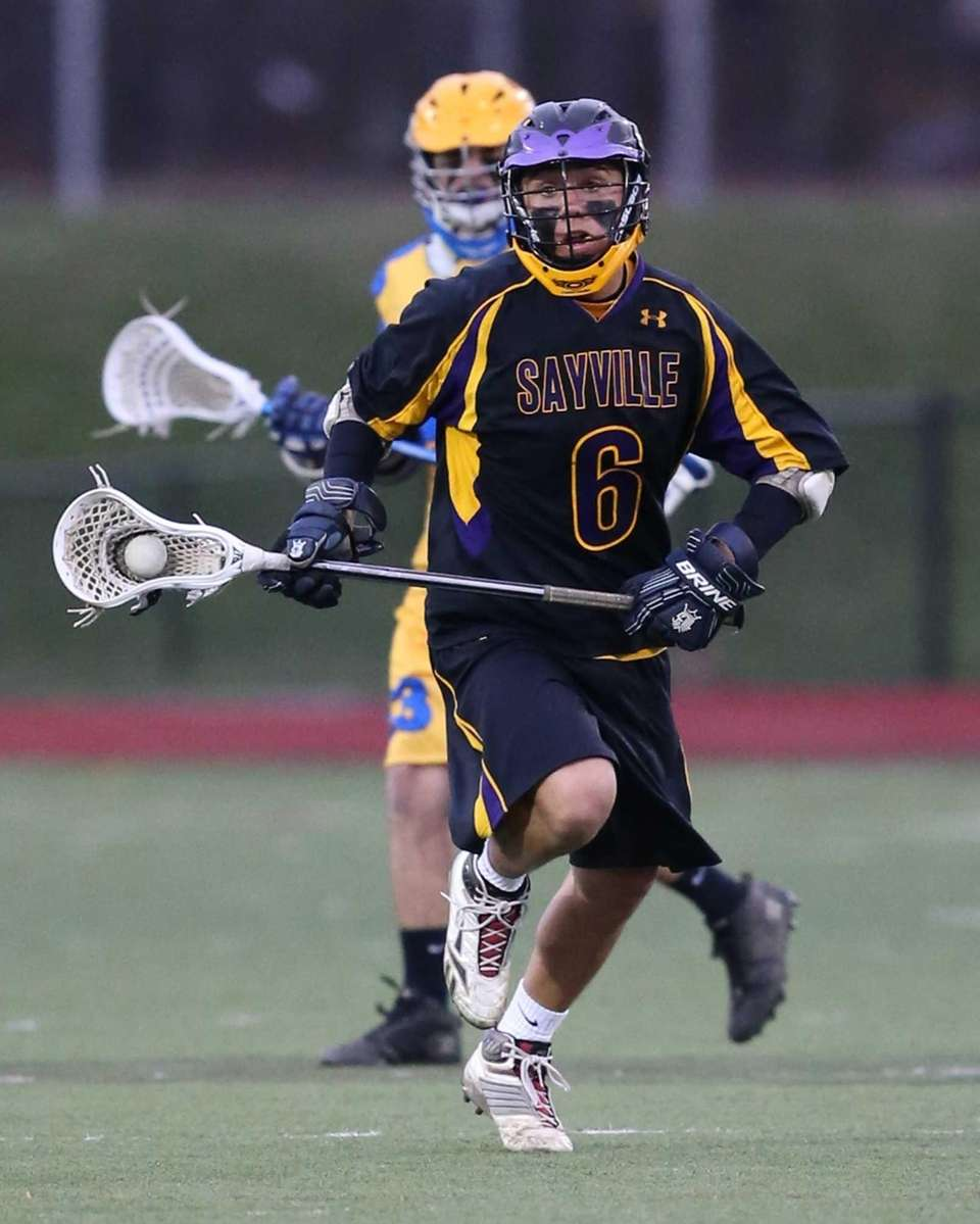 Sayville's Justin Siracusa moves the ball up field