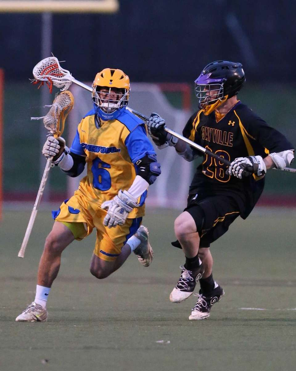 Comsewogue's Tyler DeLuca drives past Sayville defenseman Jordan