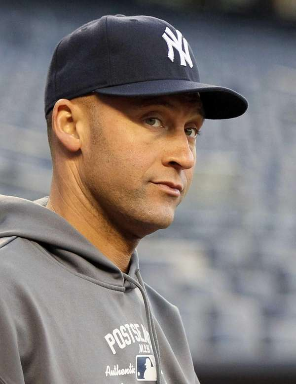 Derek Jeter warms up before Game 1 of