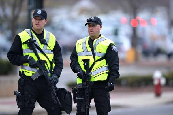 Two police officers stand guard at the perimeter