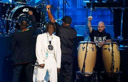 From left, Chuck D, Flavor Flav and Professor