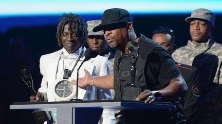 Public Enemy's Flavor Flav and Chuck D. accept
