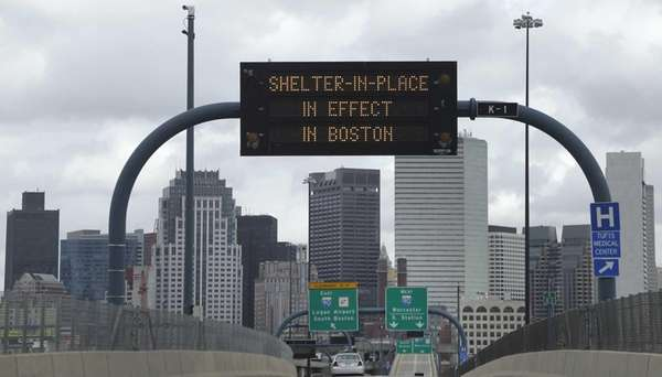 A sign calling for citizens of Boston to