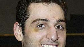 Tamerlan Tsarnaev smiles after accepting the trophy for