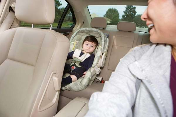 Baby in car seat while his mom is