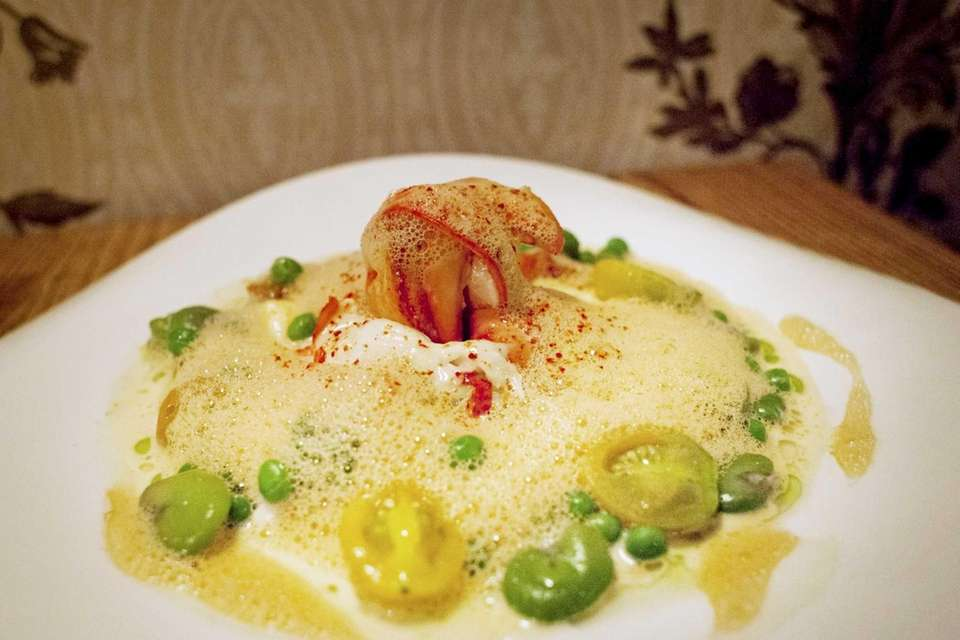 Roots Bistro Gourmand's butter-poached lobster is served with