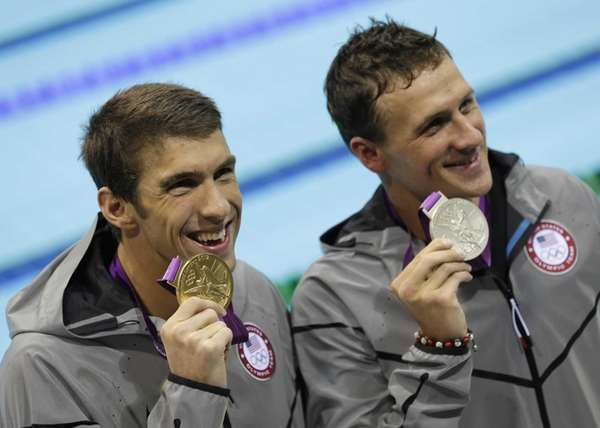 Ryan Lochte, right, and Michael Phelps pose with