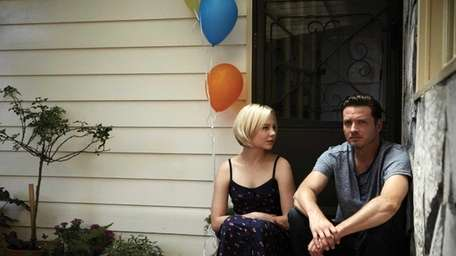 Adelaide Clemens, left, and Aden Young in a