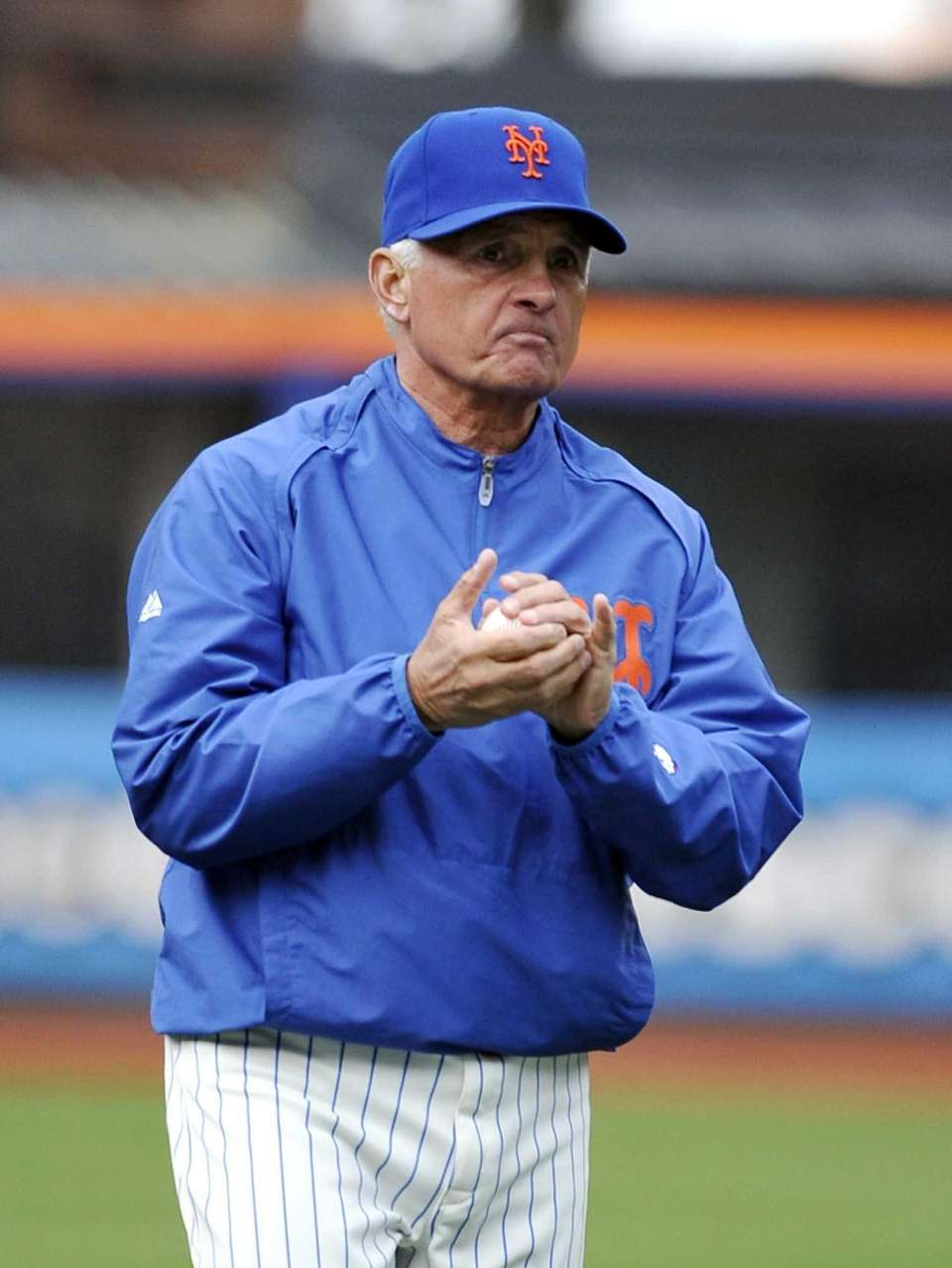 Terry Collins watches batting practice before a game