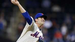 Matt Harvey of the Mets delivers a pitch