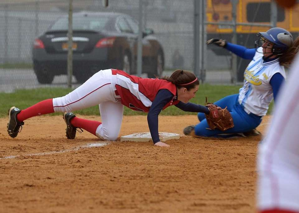 St. John the Baptist's Taylor Fay tags out