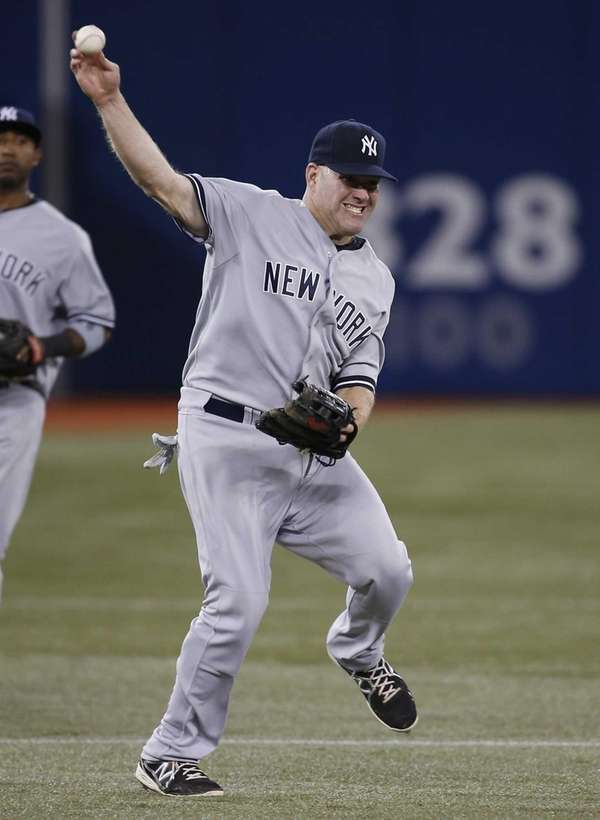 Kevin Youkilis of the Yankees tries to throw