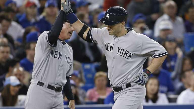 Travis Hafner of the Yankees is congratulated by