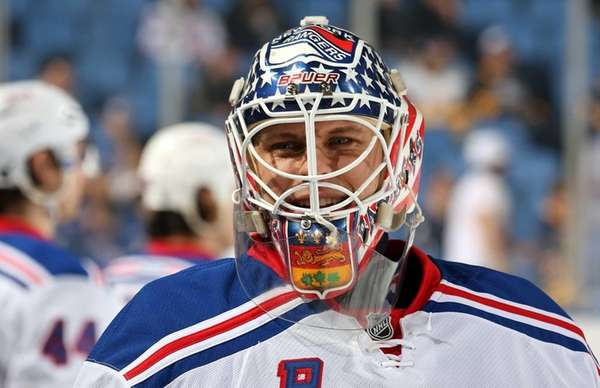 Martin Biron of the Rangers warms up to