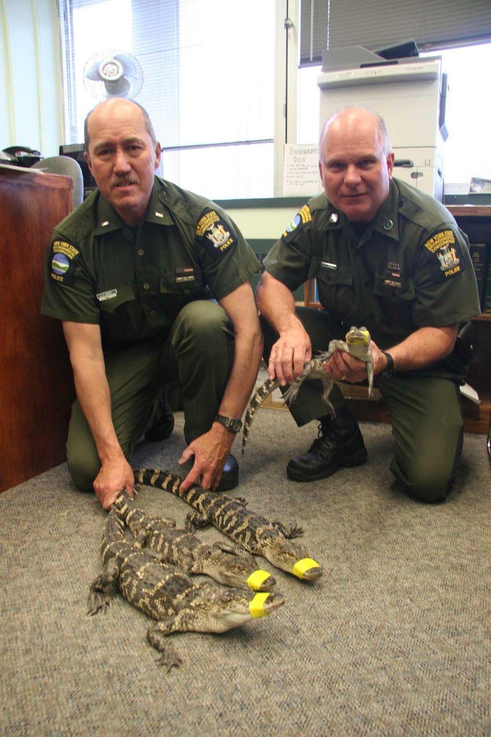 Department of Environmental Conservation Lt. Dallas Bengel, left,