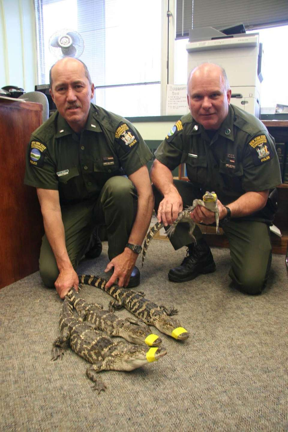 Department of Environmental Conservation Lt. Dallas Bengel, left,