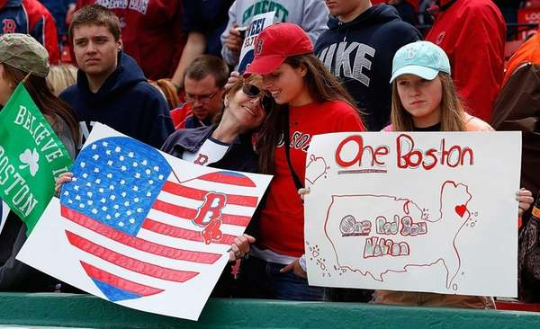 Fans hold a sign to honor the Boston