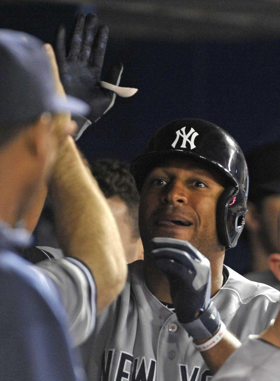 Vernon Wells celebrates a second inning home run