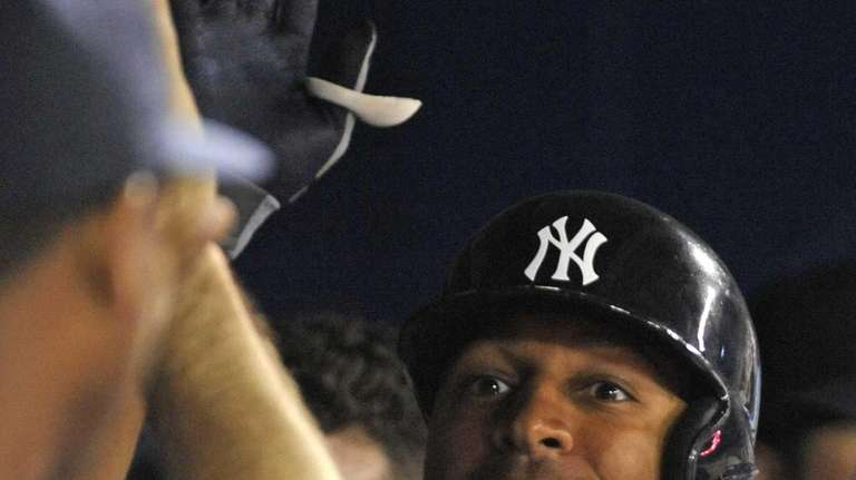 Vernon Wells celebrates a second inning home run