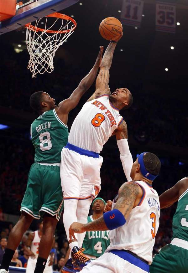 J.R. Smith of the Knicks dunks the ball