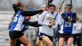 Massapequa's Kristin Yevoli looks to get past the