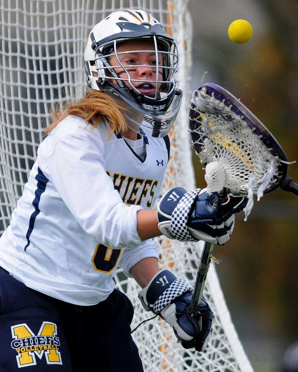 Massapequa goalie Samantha DePasquale secures a loose ball