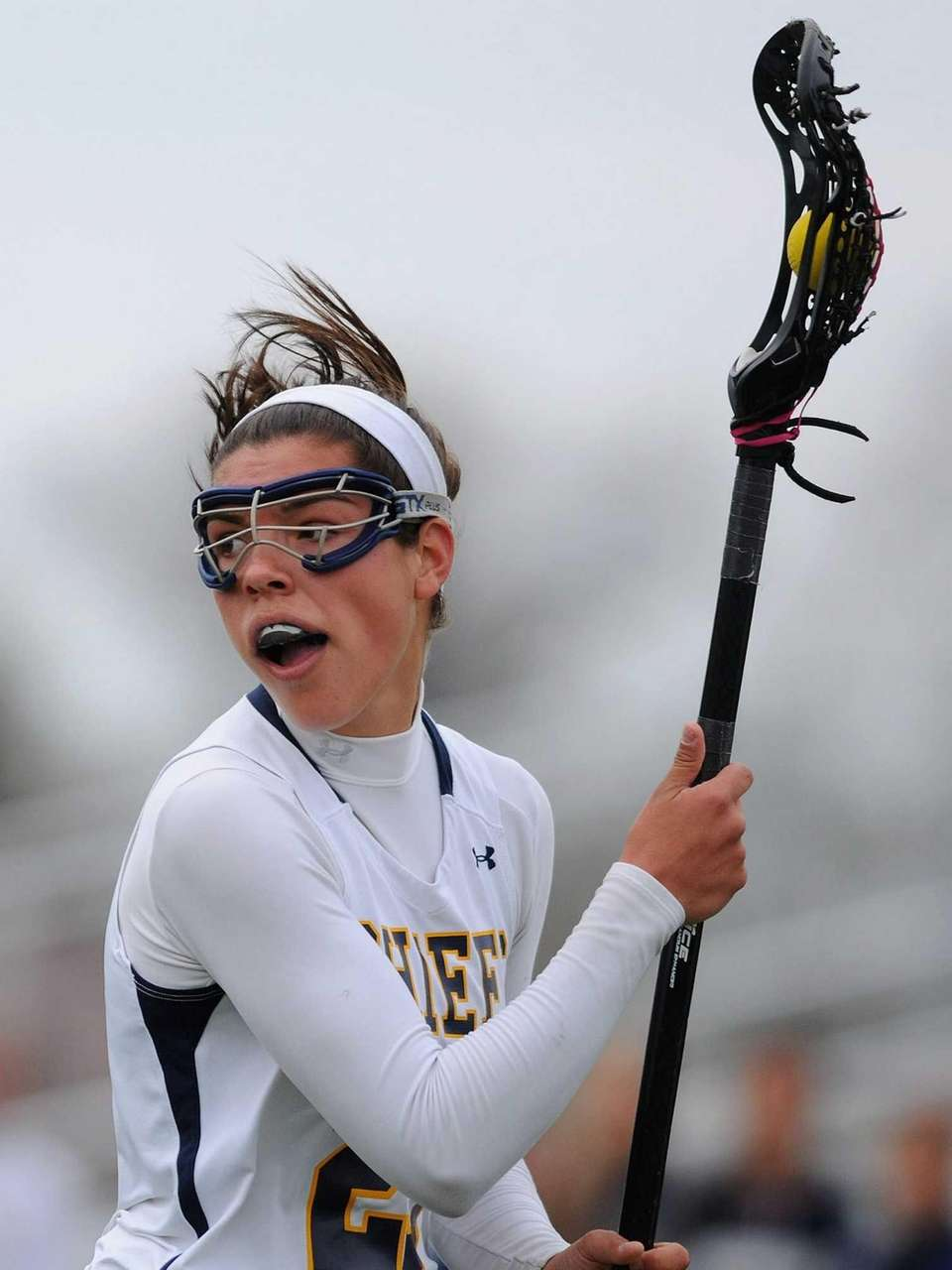 Massapequa's Olivia Batista looks to make a pass