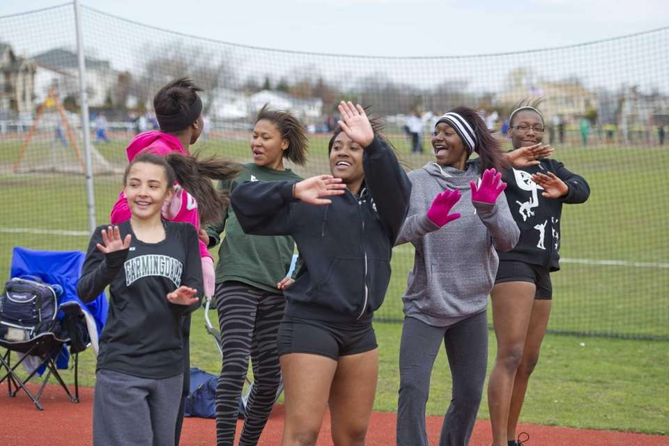 The Farmingdale track team is seen dancing during