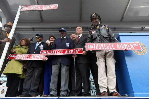 From right, Tuskegee Airmen Julius T. Freeman and
