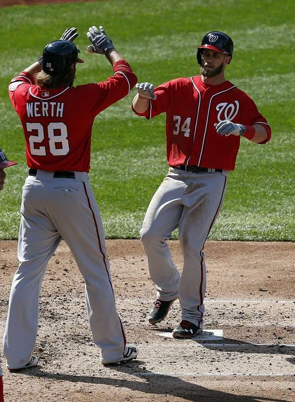 Washington Nationals center fielder Bryce Harper is congratulated